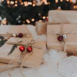 presents wrapped in brown paper and decorated with jingle bells